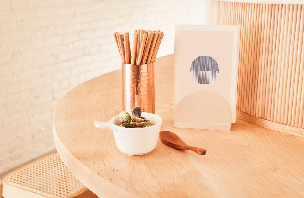 Bar with menu, chopsticks, and food