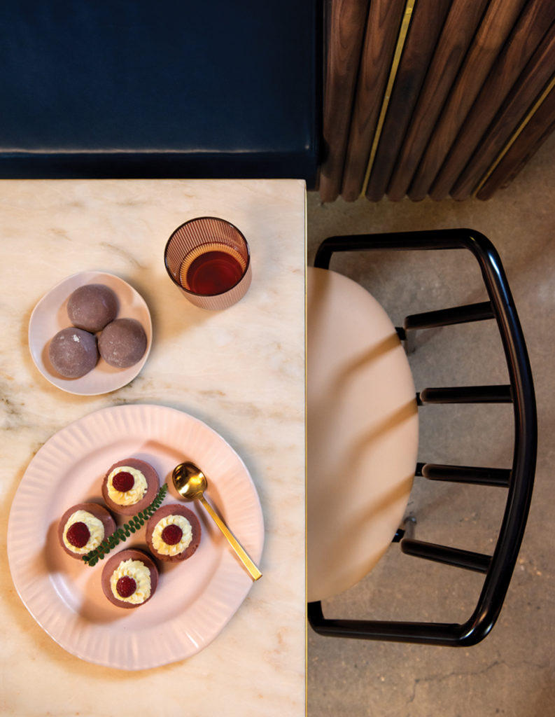 Table and chairs with sweets.