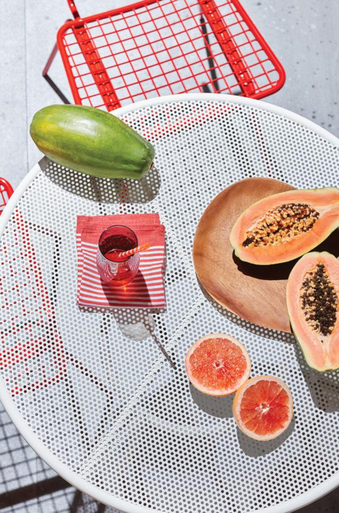 Papaya and fruits on table
