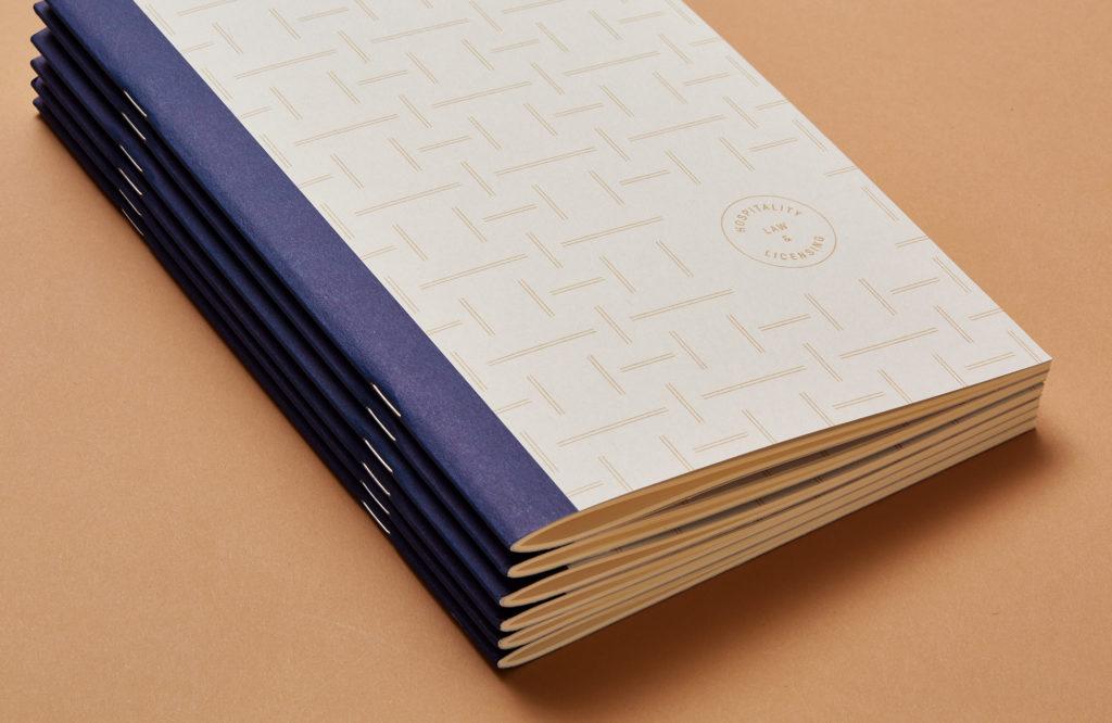 stack of Helbraun Levey notebooks