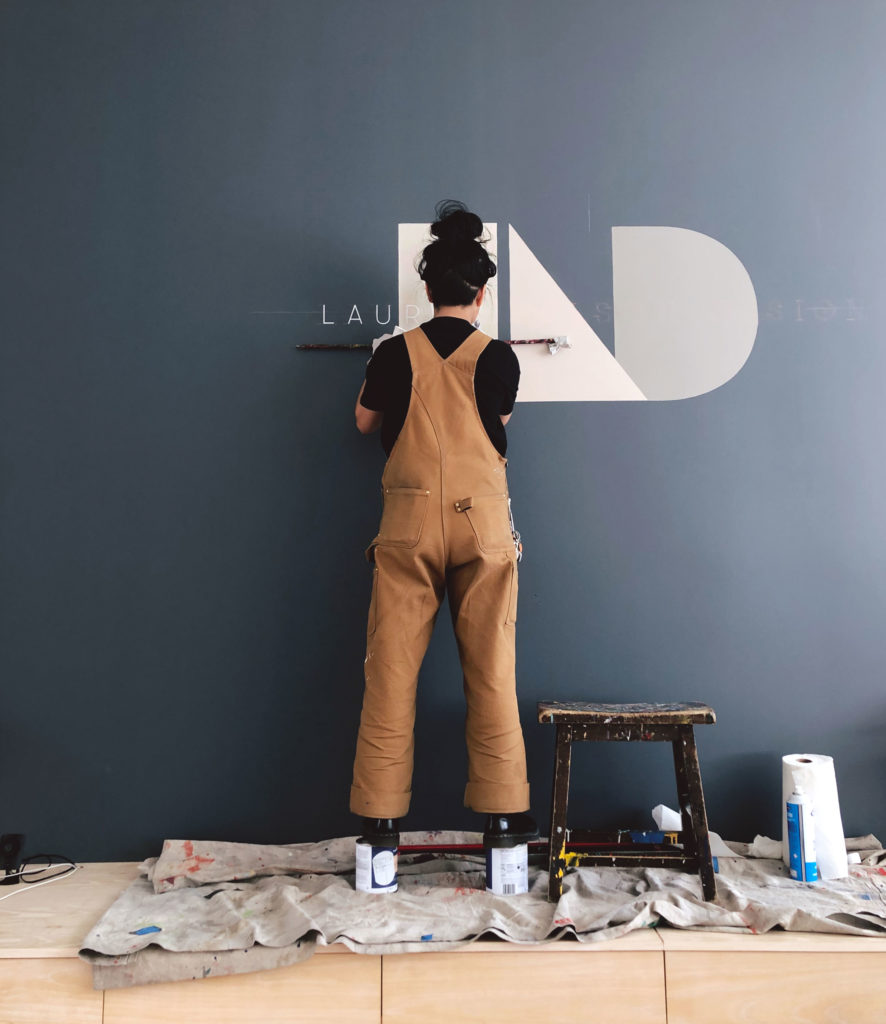 Artist painting LND sign
