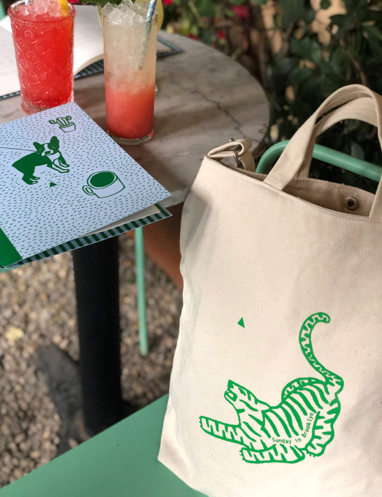 Sunday in Brooklyn tote and menu with drinks