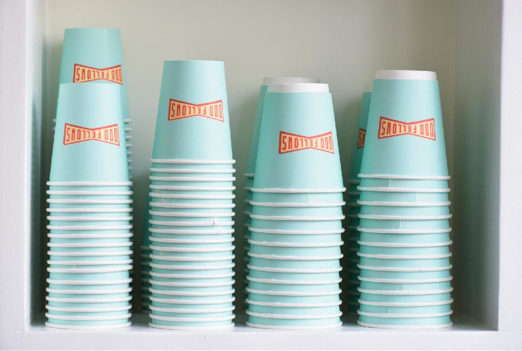 stacks of OddFellows coffee cups